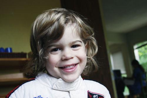 Tucker, smiling racecar suit
